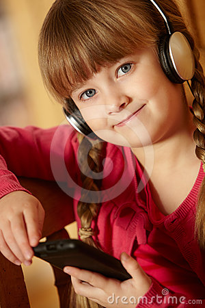Young Girl Listening To MP3 Player
