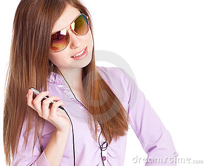 Young girl listening to music om mp3 player
