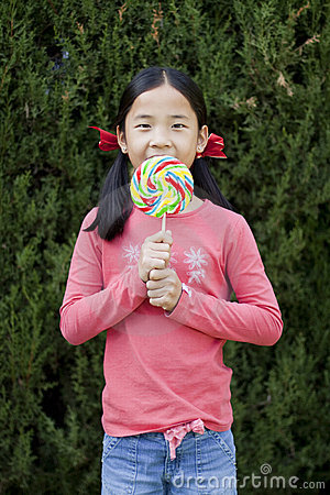 Young girl and a lollipop