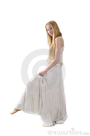Young girl in long withe dress