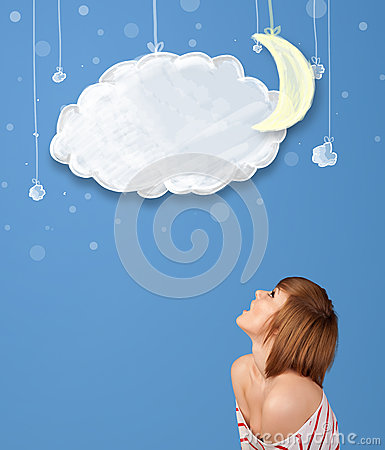Young girl looking at cartoon night clouds with moon Stock Photo