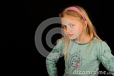 Young girl looking cross