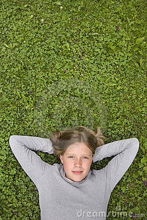Free Young Girl Lying In The Grass Dreaming Of ... Stock Images - 18484324