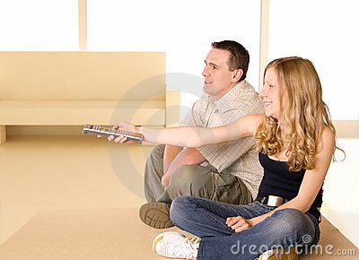 Young Girl And Man Watching TV