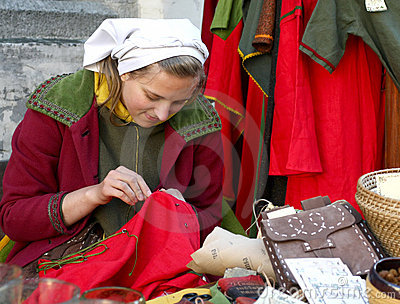 Young girl in medieval dress in Tallinn Editorial Photo
