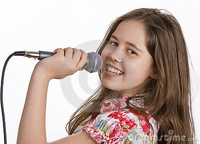 Young girl with microphone singing
