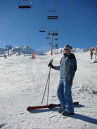 The young girl on a mounting skiing resort
