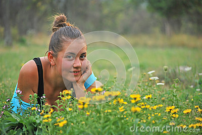 Young girl near yellow flowers