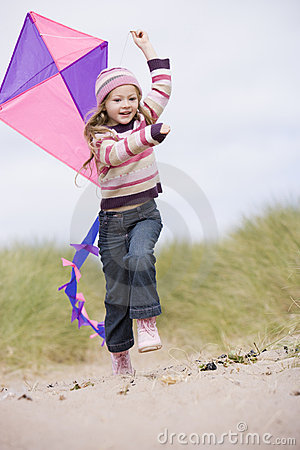 Free Young Girl On Beach With Kite Smiling Royalty Free Stock Images - 5937529