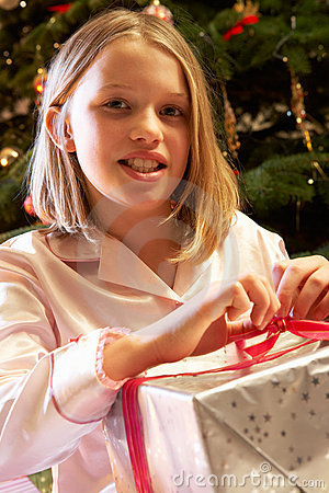 Young Girl Opening Christmas Present