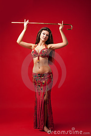 Young girl in oriental arabic costume with cane