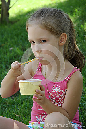 Free Young Girl Outdoors Eating Ice Cream Stock Photography - 50801852