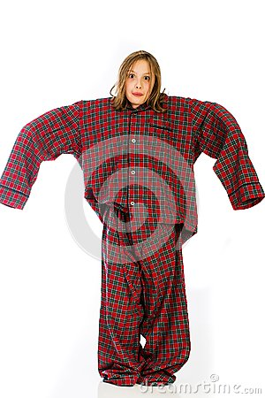 Young girl in over sized pajamas