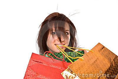 The young girl with packages after shopping.