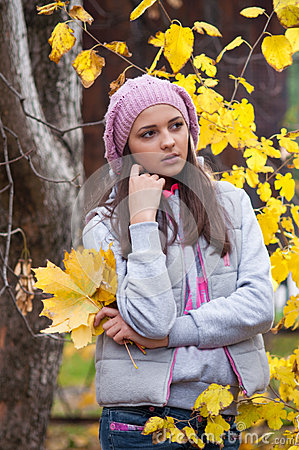 Young girl in a park in autumn