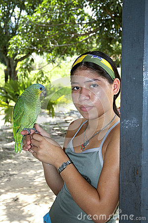 Young girl with parrot Editorial Photography