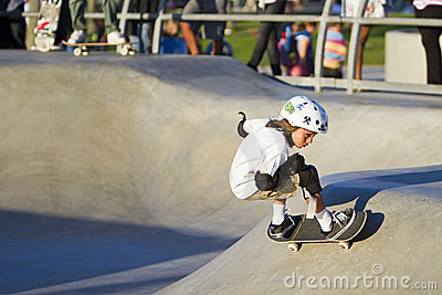 Young Girl Performing At Skateboard Park Editorial Stock Image