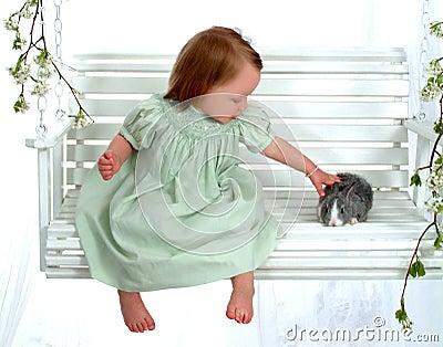 Young Girl Petting Bunny