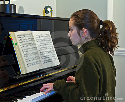 young girl, piano and book