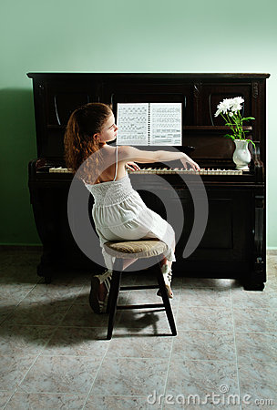Young girl and piano at home