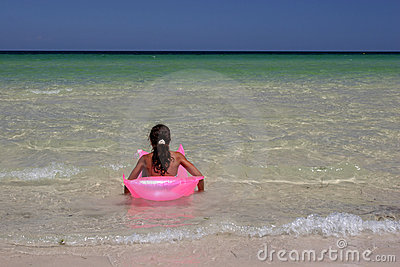 Young girl on pink air-bed in