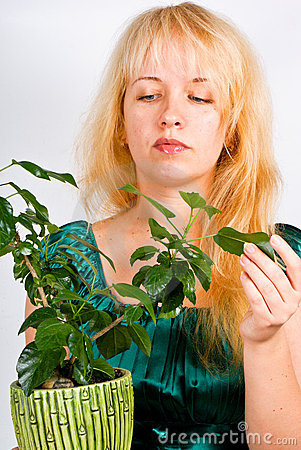 Young girl with plant