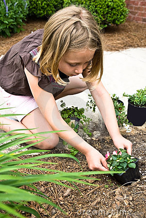 Young Girl Planting Flowers