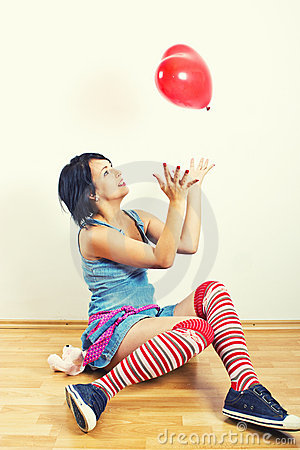 Young girl playing with balloon