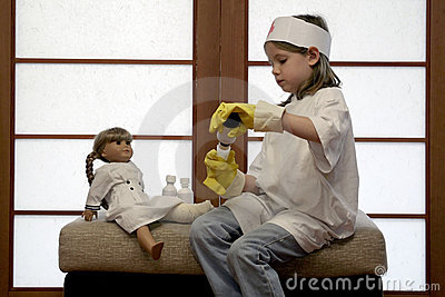 Young girl playing doctor