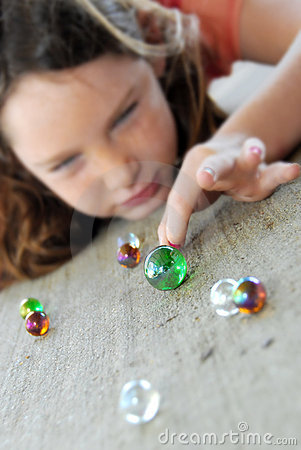 Free Young Girl Playing Marbles Royalty Free Stock Image - 9023566