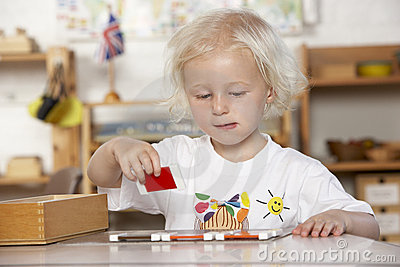 Young Girl Playing at Montessori/Pre-School