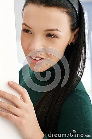 Young girl playing peek-a-boo
