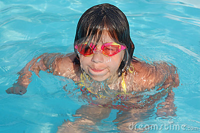 Young girl playing in the pool