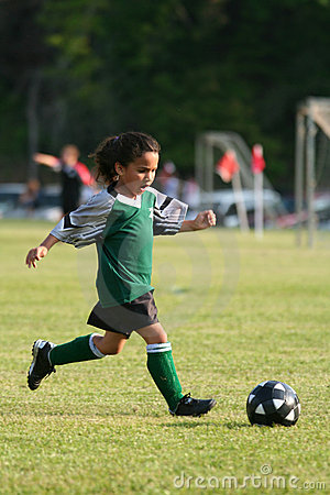 Free Young Girl Playing Soccer Stock Photo - 740770