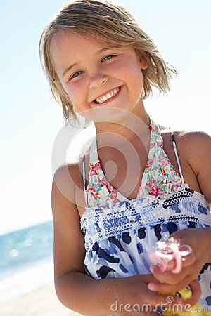 Young Girl Playing On Sunny Beach