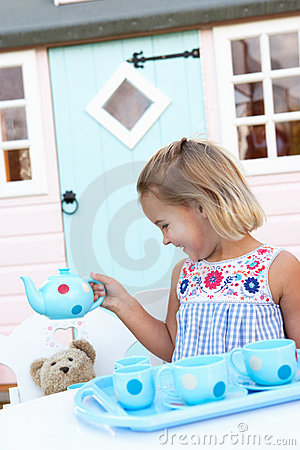 A young girl plays outdoors