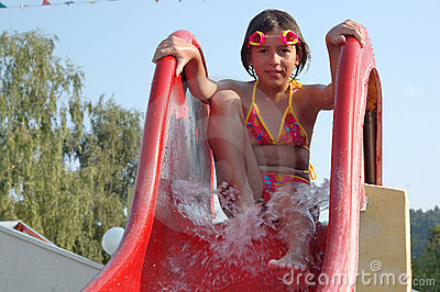 Young girl on a pool slide