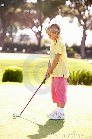 Young Girl Practising Golf