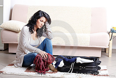 Young girl preparing her luggage before travel