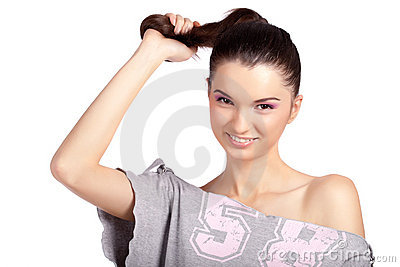 Young girl pulling her hair and smiling