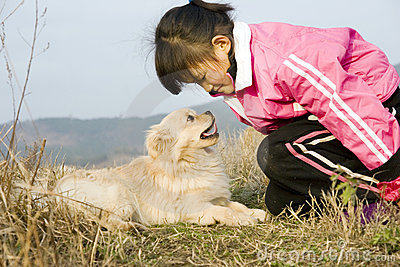 Young girl and puppy
