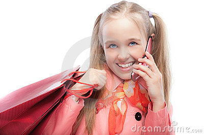 Young girl with purchases speaks by