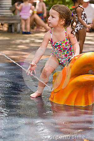 Young girl playing in water