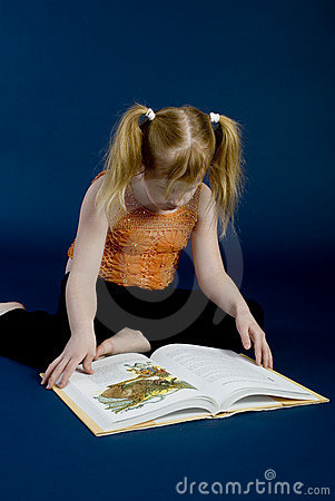 Young girl is reading a book