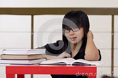 Young girl reading books