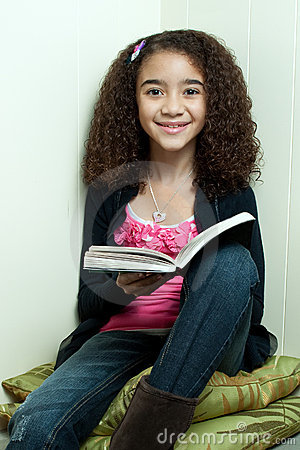 Young girl reading in corner