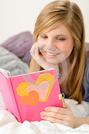 Young girl reading her journal of memories