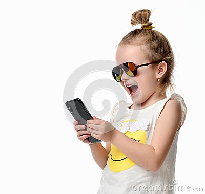Free Young Girl Reading Texting Sms On The Cellphone Mobile With Touch Screen In Sunglasses Royalty Free Stock Photo - 107410705