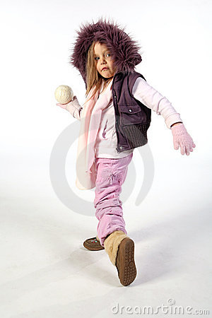 Young girl ready to throw snowball