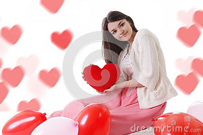 Young girl with red balloons on heart-shaped bokeh